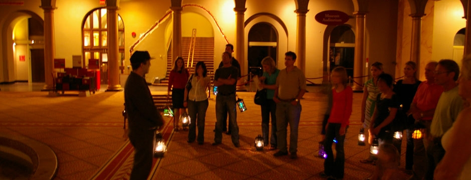 Museum visitors meet their tour guide after hours for a Ghost Tour. Photo by Museum staff.